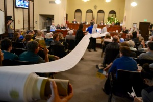 As Marilyn spoke, other members of BSHC unrolled thousands of signed letters opposing the crude-by-rail project and heaped them before the city council members.