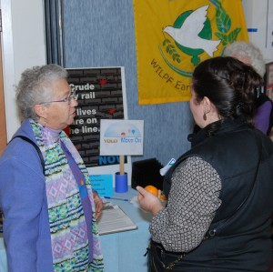 Elizabeth Lasensky of Yolo MoveOn talked to community members at the Jan. 8 gathering on climate justice.